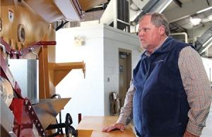 Dale County farmer Chris Thompson examines new farm equipment at the trade show.